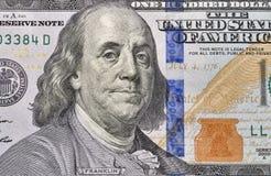 One hundred dollar bill fragment closeup. US President Benjamin Franklin portrait on one hundred dollar bill fragment macro Royalty Free Stock Images