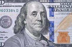 One hundred dollar bill fragment closeup. US President Benjamin Franklin portrait on one hundred dollar bill fragment macro Stock Image