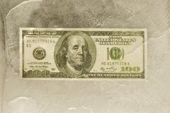 One Hundred Dollar Bill Frozen in Ice Royalty Free Stock Images