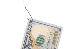 One hundred dollar bill on a hook. Stock Photo