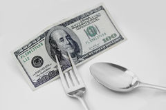 One hundred dollar bill on plate to be eaten Royalty Free Stock Image
