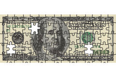 One hundred dollar bill puzzle. One hundred dollar bill collected as a puzzle Stock Images