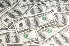 One hundred dollar bills. Several one hundred dollar bills scattered Royalty Free Stock Image