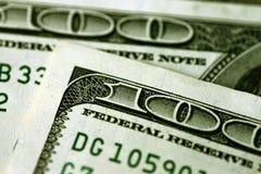 One hundred Dollar Bills. Macro image of a couple of one hundred Dollar Bills Stock Photo