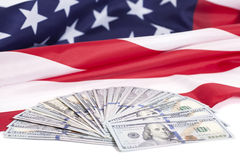 One hundred dollar bills with American flag Royalty Free Stock Photography