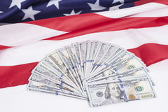 One hundred dollar bills with American flag Royalty Free Stock Photos