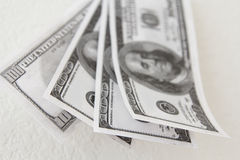 One hundred dollar bills. Blurred one hundred dollar bills on a white background Stock Photo