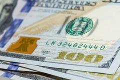 One hundred dollar bills close up with selective focus Stock Photos