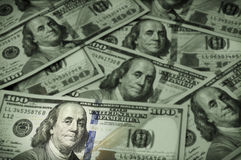 One hundred dollar bills, focus on Benjamin Franklin Royalty Free Stock Photo