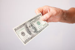 One hundred dollar bills in hand Stock Photo
