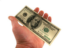 One hundred dollar bills in a hand Stock Images