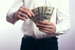 One hundred dollar bills in the hands Royalty Free Stock Image