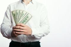 One hundred dollar bills in the hands Royalty Free Stock Images