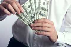 One hundred dollar bills in the hands Royalty Free Stock Photos