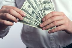 One hundred dollar bills in the hands Royalty Free Stock Photography