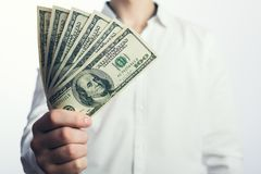 One hundred dollar bills in the hands Stock Photos
