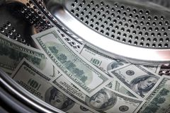 One Hundred Dollar Bills In A Washing Machine, Money Laundering. Stock Photo