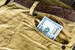 One hundred dollar bills in jeans pocket Royalty Free Stock Image