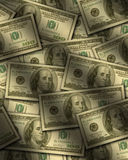 One hundred dollar bills lying flat Stock Photo