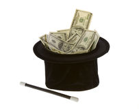 One Hundred Dollar Bills In A Magic Hat with Wand. US Currency One Hundred Dollar Bills in a black magic hat with a magic wand, isolated on white background Royalty Free Stock Photo