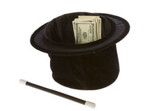 One Hundred Dollar Bills In A Magic Hat with Wand. US Currency One Hundred Dollar Bills in a black magic hat with a magic wand, isolated on white background Stock Photography