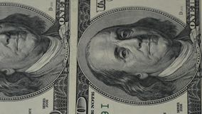 One hundred dollar bills. The motion camera slider. Macro photography of banknotes. Portrait of Benjamin Franklin close. Up. 4k stock video footage
