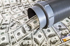 One hundred dollar bills out of pipes Royalty Free Stock Photos