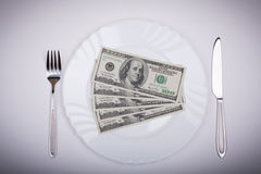 One hundred dollar bills on  plate Stock Photos