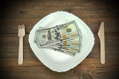 One Hundred Dollar Bills On The Plate. Wood Background. Stock Photography