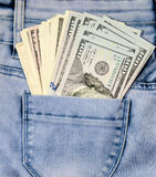 One hundred dollar bills in the pocket jeans Stock Photos
