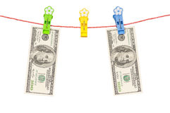 One hundred dollar on clothesline Royalty Free Stock Images