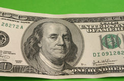 One hundred dollar note. Close-up of a One hundred dollar note, backhround is green Royalty Free Stock Photography