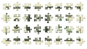 One Hundred Dollar Puzzle Pieces Royalty Free Stock Photo