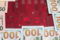 One hundred dollar with red computer motherboard Stock Photos