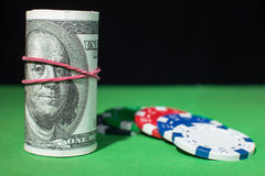 One hundred Dollar roll, poker chips on a Royalty Free Stock Photo