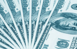 One hundred dollar's banknotes. Blue toned Royalty Free Stock Photo