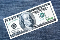 One Hundred Dollars. Over jeans Royalty Free Stock Image