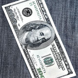 One Hundred Dollars. Over jeans Stock Images