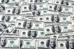 One hundred dollars. A lot of one hundred dollars banknotes as a background Stock Image