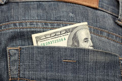 One hundred dollars in the back pocket Royalty Free Stock Photography