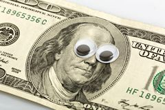 One hundred dollars banknote. With funny eyes Royalty Free Stock Photography