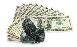One hundred dollars banknote and raw coal Stock Image