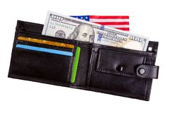 One hundred dollars banknote reach out out of a black old purse. Royalty Free Stock Images