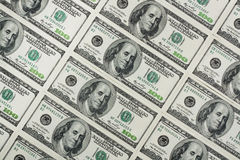 One hundred dollars banknotes. Placed in rows and columns with incline stock photography