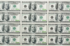 One hundred dollars banknotes. Placed in rows and columns Royalty Free Stock Photos