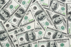 One hundred dollars banknotes. Placed in a random way Royalty Free Stock Photo