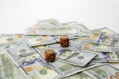 One hundred dollars banknotes and dice. Concept of luck. One hundred dollars banknotes and two lucky dice. Concept of game and luck Royalty Free Stock Photography