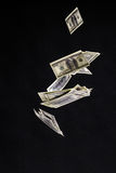 One hundred dollars banknotes isolated fly on black background. Royalty Free Stock Photography