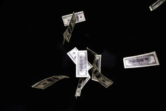 One hundred dollars banknotes isolated fly on black background. Money rain concept Stock Images