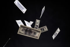 One hundred dollars banknotes isolated fly on black background. Money rain concept Stock Photo
